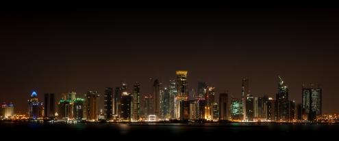 The dazzling skyscrapers of Doha along Al Corniche at night