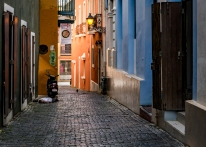 A man taking an afternoon siesta next to his scooter in an alley in Old San Juan (Puerto Rico)