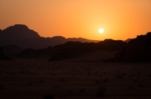 A lovely blood-orange sunset over the Wadi Rum desert.