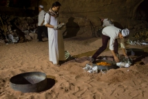 Traditional Bedouin cooking technique of burying food with coals to cook in the desert.